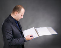 Young businessman with folders Stock Photos