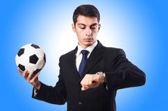 Young businessman with football Royalty Free Stock Photos