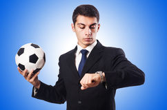 Young businessman with football on white Stock Photo