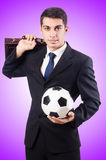 Young businessman with football on white Royalty Free Stock Photos