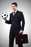Young businessman with football on white Royalty Free Stock Photo