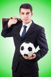 Young businessman with football on white Stock Photos