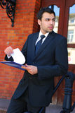Young businessman in the front of bank Royalty Free Stock Photos