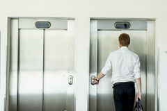 Young businessman in front of  elevator Royalty Free Stock Photography