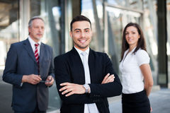 Young businessman in front of a group of business people outdoor Royalty Free Stock Image