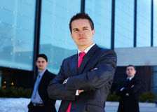 A young businessman in front of his colleagues Royalty Free Stock Image