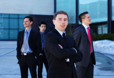 A young businessman in front of his team Royalty Free Stock Photos