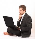 Young businessman in front of a laptop royalty free stock image