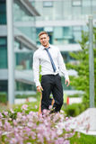 Young businessman in front of the office Royalty Free Stock Photography