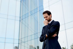 Young businessman frowned thinking on the project Stock Photo