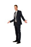Young businessman full length portrait. Approachable young business man with open arms isolated Royalty Free Stock Image