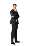 Young businessman full length portrait. Young business man thinking full length portrait Royalty Free Stock Image