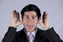 Young businessman with a funny face Royalty Free Stock Photography