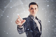 Young businessman and futuristic network concept Stock Photography