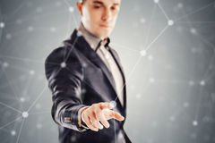 Young businessman and futuristic network concept Stock Photo