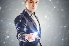 Young businessman and futuristic network concept Stock Images