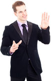Young businessman gesturing Royalty Free Stock Images