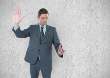 Young businessman gesturing against wall Royalty Free Stock Photos
