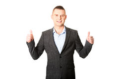 Young businessman gesturing ok sign Stock Photography