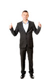 Young businessman gesturing ok sign. Young smiling businessman gesturing thumbs up Royalty Free Stock Images
