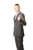 Young businessman gesturing ok sign Royalty Free Stock Photo