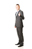 Young businessman gesturing ok sign Royalty Free Stock Photos