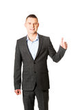 Young businessman gesturing ok sign Royalty Free Stock Photography
