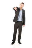Young businessman gesturing thumbs down Stock Images