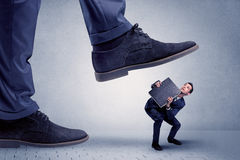 Young businessman getting crushed Stock Image