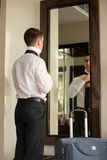 Young businessman getting dressed Royalty Free Stock Photos