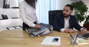 Young businessman getting rebuke from his female boss in the office, 4K.  stock video