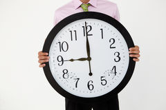 Young businessman with giant clock Stock Photography