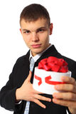Young businessman gives box with gift Stock Photography