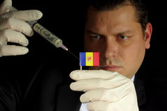 Young businessman gives a financial injection to Andorran flag Royalty Free Stock Image