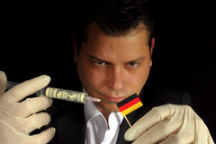 Young businessman gives a financial injection to German flag iso Stock Photography
