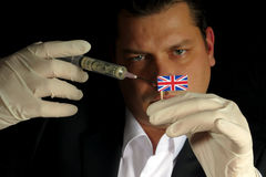 Young businessman gives a financial injection to United Kingdom Stock Photo