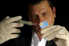 Young businessman gives a financial injection to Uruguayan flag Stock Image