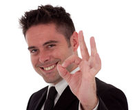 A young businessman gives the okay sign Stock Image