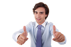 Young businessman giving consent, with thumb up Stock Photos