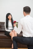 Young businessman giving a flower to pretty Royalty Free Stock Images