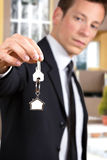 Young businessman giving house keys Stock Image