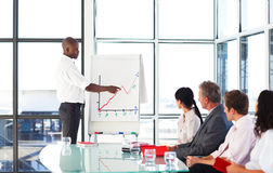 Young businessman giving a presentation Stock Images