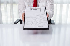 Young businessman giving a resume Royalty Free Stock Image