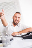 Young businessman giving thumbs up Stock Image
