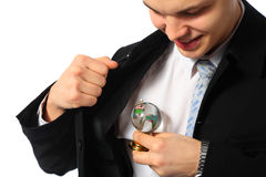 Young businessman with glass globe in hand Stock Photography