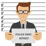 Young businessman with glasses posing for mugshot holding signboard with police debt text Stock Photo