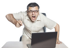 Young businessman in glasses shouts. Young businessman wearing glasses in a rage shouting on an isolated white background Stock Images
