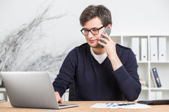 Young businessman in glasses working on computer Royalty Free Stock Images