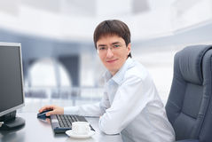 Young businessman in glasses working at his office. Royalty Free Stock Photography