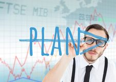 Young businessman with glasses writing Plan (with arrow) in the screen. Stock market background Stock Photography
